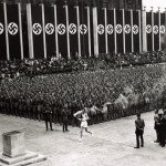 Olympic torch enters 'stadium swastika' in 1936