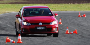 Driving test through lines of cones.