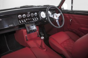 Five-speed manual gearbox and a sea of red leather