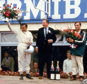 Bruce McLaren (left) Henry Ford II and Chris Amon celebrate the 1966 win