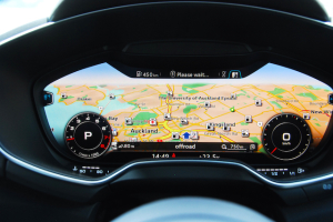 The rev counter and speedo have been minimised on the cluster to highlight the sat-nav map