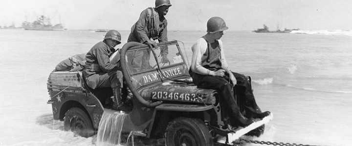 A Jeep being towed ashore in the Pacific in 1942