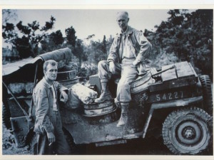 Ernie Pyle seated on a Jeep in Okinawa in 1944, not long before he was killed by fire from a Japanese machine gun