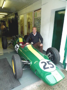 Clive Chapman with Lotus 25, the car Jim Clark raced in the NZ Grand Prix in 1968