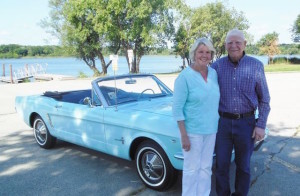 Gail and Tom Wise with their baby blue soft-top