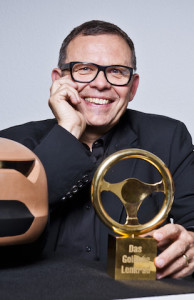 Kia design chief Peter Schreyer with Germany's Golden Steering Wheel award