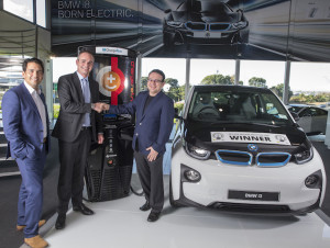 Transport Minister Simon Bridges, BMW NZ chief Florian Renndorfer, and Charge Net NZ's Steve West