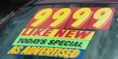 stock-photo-windshield-price-sticker-on-a-used-car-lot-for-sale-76962058