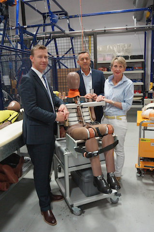 ANCAP chief executive James Goodwin (left) and staff with a new crash test dummy